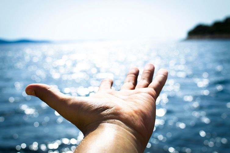 Man feeling freedom on open sea