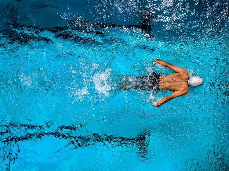 - Person Swimming on Body of Water (1)